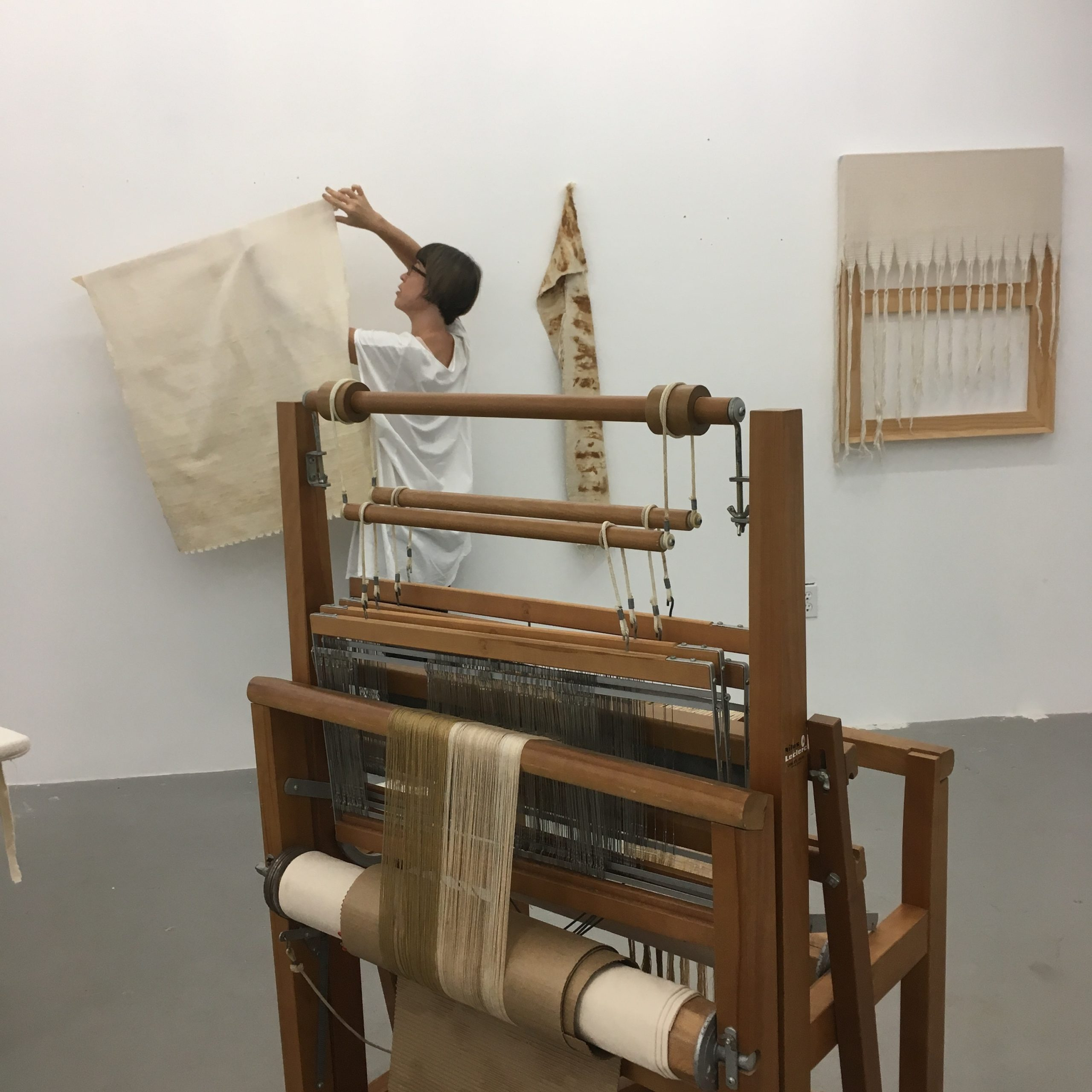Frances Trombly installs her fabric sculpture in her studio.