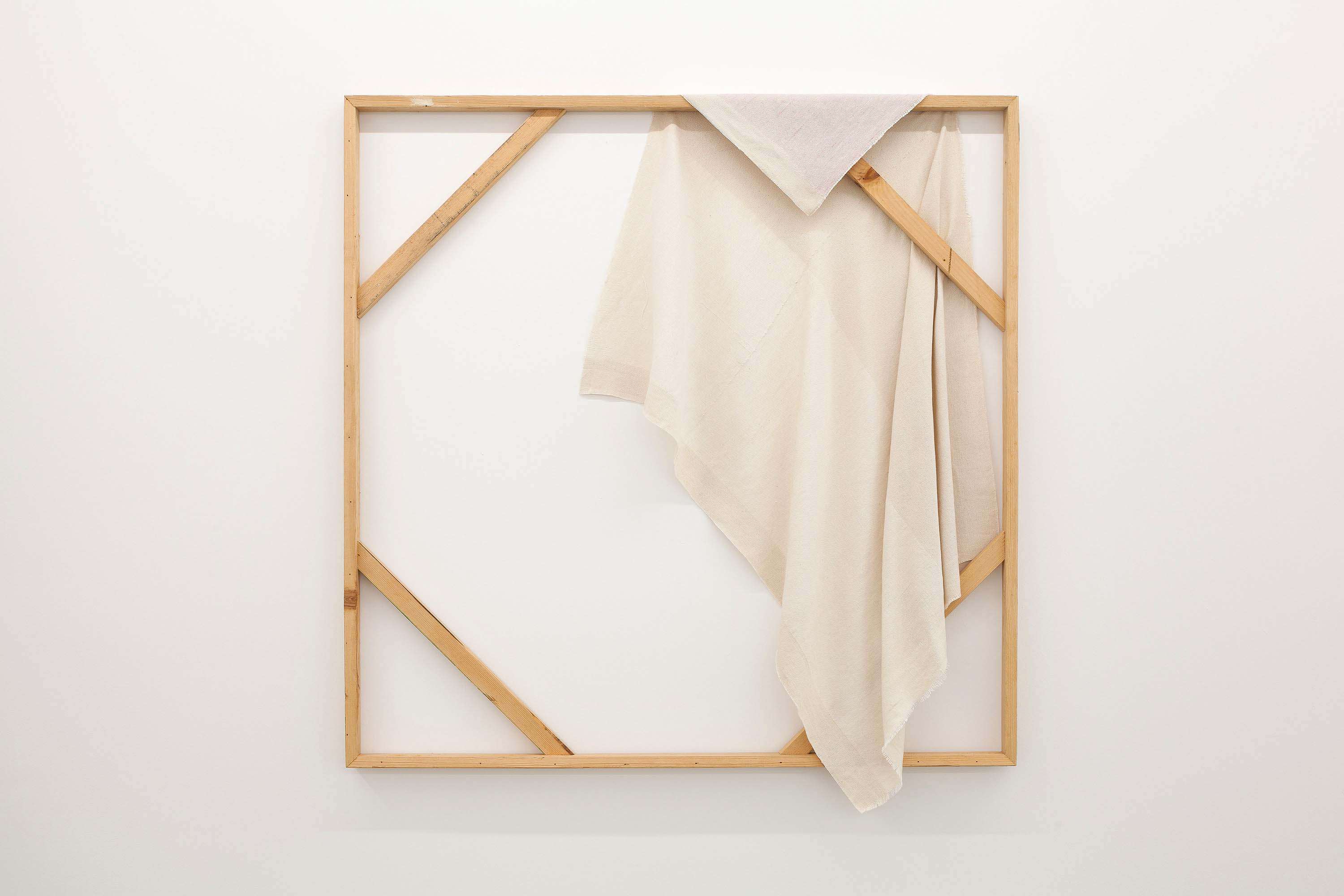Frances Trombly carefully drapes her hand woven canvas over stretcher bars.